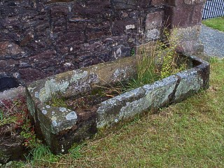 Stone Coffin outside the church