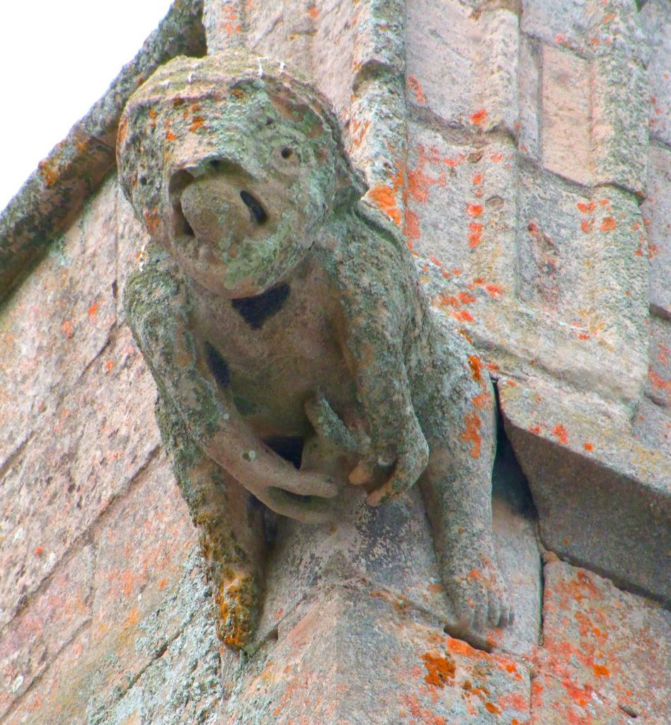 Monstrous ithyphallic figure on the church tower