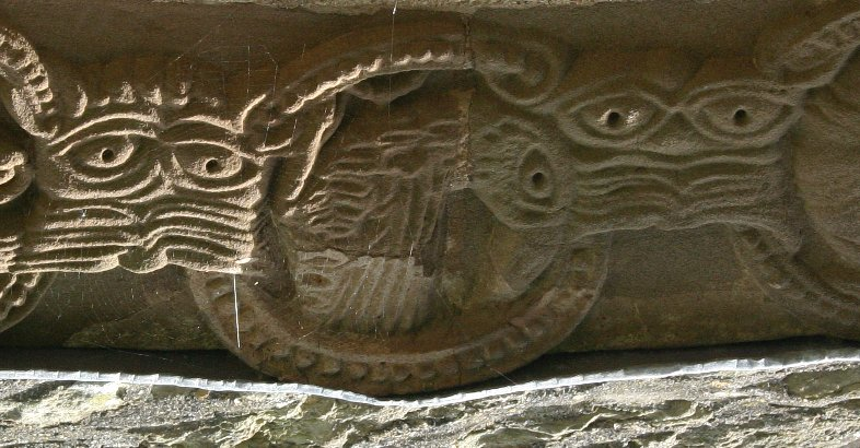 Examples of the striated monstrous head motif on the doorway at Kilpeck. (Image Inverted for clarity)