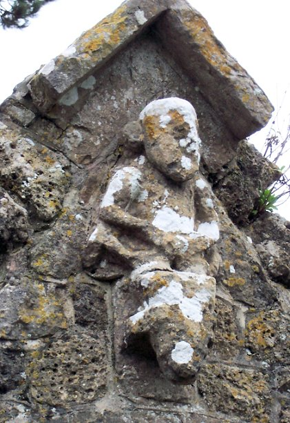 Side view of the Sheela and beast head