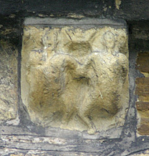 Splay legged pair. Now worn or defaced this corbel seems a likely candidate for having once been exhibitionist.