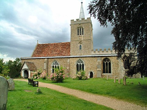 Whittlesford Church. The figures can be seen just under the clock